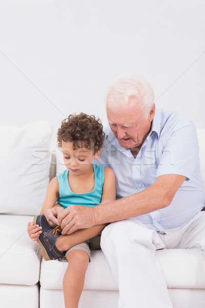 Grandson tying his shoelaces with his grandfather Stock photo © wavebreak_media