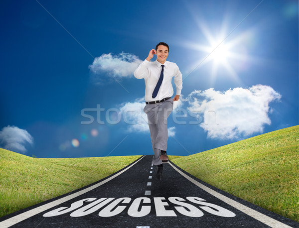 Happy businessman running on a road Stock photo © wavebreak_media