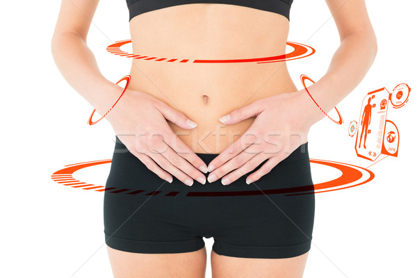 Composite image of closeup mid section of a fit woman with stoma Stock photo © wavebreak_media