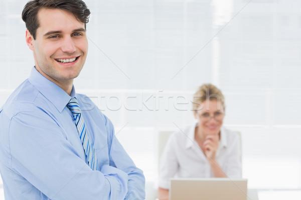 улыбаясь бизнесмен женщину рабочих за служба Сток-фото © wavebreak_media