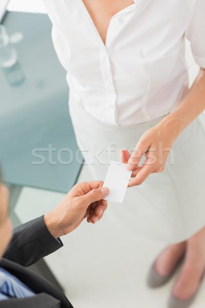 Businessman giving businesswoman his card Stock photo © wavebreak_media