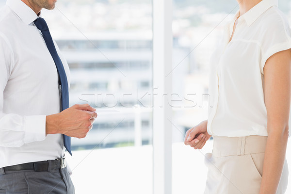 Mid section of executives exchanging business card Stock photo © wavebreak_media