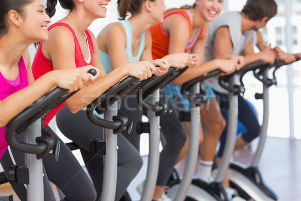 Fit people working out at spinning class Stock photo © wavebreak_media