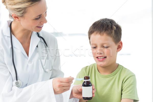 Pediatra piccolo ragazzo sciroppo femminile ospedale Foto d'archivio © wavebreak_media