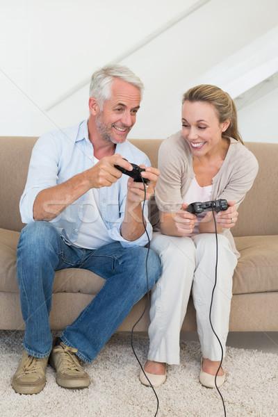 幸せ カップル ソファ 演奏 ビデオゲーム ストックフォト © wavebreak_media