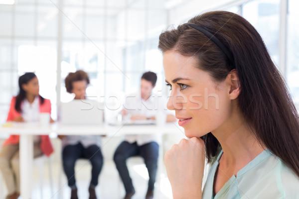 Attractive businesswoman being thoughtful Stock photo © wavebreak_media