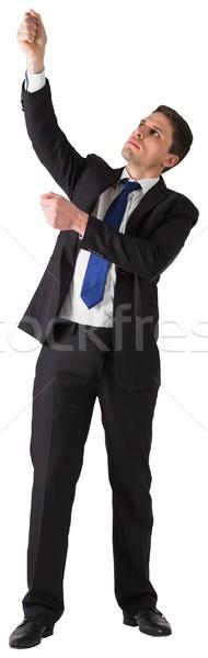 Handsome businessman pulling with hand Stock photo © wavebreak_media