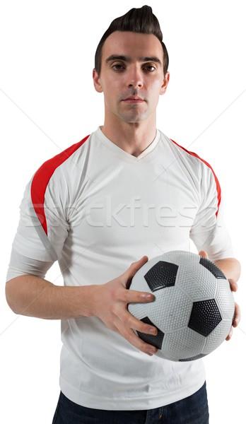 Guapo fútbol ventilador mirando cámara blanco Foto stock © wavebreak_media