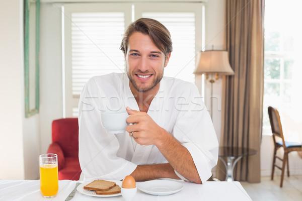 Yakışıklı adam kahvaltı bornoz gülen kamera ev Stok fotoğraf © wavebreak_media