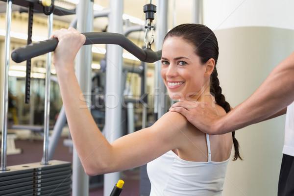 Fitt barna hajú súlyok gép karok edző Stock fotó © wavebreak_media