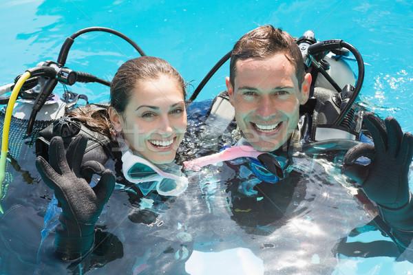 笑みを浮かべて カップル スキューバダイビング 訓練 スイミングプール ストックフォト © wavebreak_media