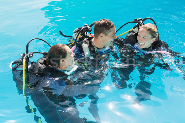 Smiling friends on scuba training in swimming pool Stock photo © wavebreak_media