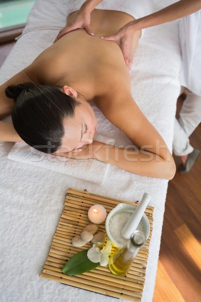 Brunette enjoying a massage with beauty treatments beside Stock photo © wavebreak_media