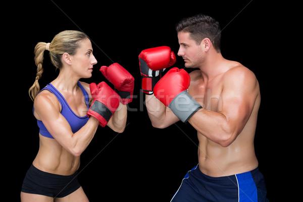Bodybuilding paar poseren bokshandschoenen zwarte vrouw Stockfoto © wavebreak_media