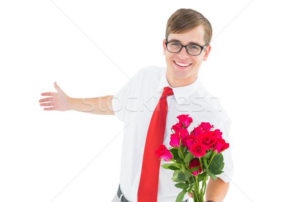 Geeky hipster offering bunch of roses Stock photo © wavebreak_media