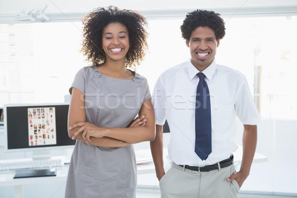 молодые команда улыбаясь камеры вместе Creative Сток-фото © wavebreak_media