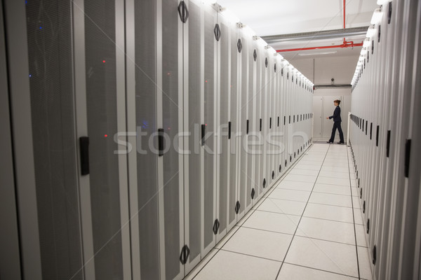 Technician walking in server hallway Stock photo © wavebreak_media