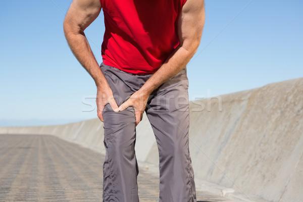 Aktív idős férfi megérint sebesült comb Stock fotó © wavebreak_media