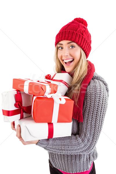 ünnepi szőke nő tart köteg ajándékok fehér Stock fotó © wavebreak_media