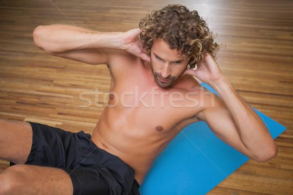 Shirtless man doing push ups in gym Stock photo © wavebreak_media