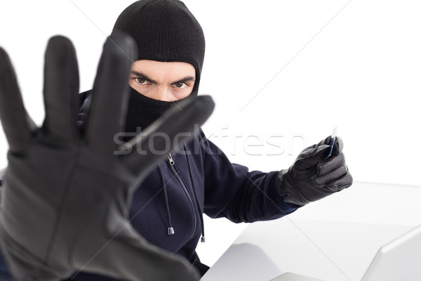 Angry hacker using credit card and gesturing Stock photo © wavebreak_media