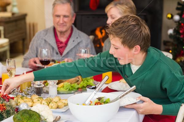 Uitgebreide familie christmas tafel home woonkamer vrouw Stockfoto © wavebreak_media