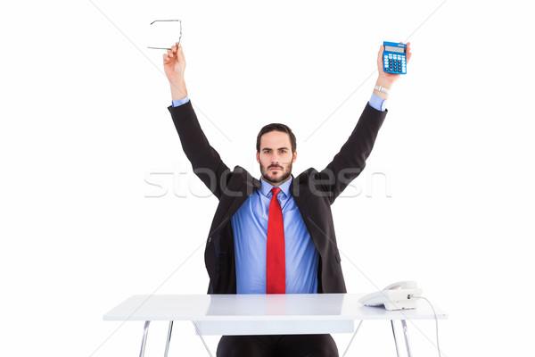 üzletember magasra tart olvasószemüveg számológép fehér férfi Stock fotó © wavebreak_media