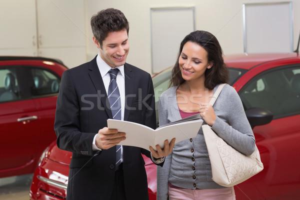 Satıcı broşür müşteri gülen yeni araç Stok fotoğraf © wavebreak_media