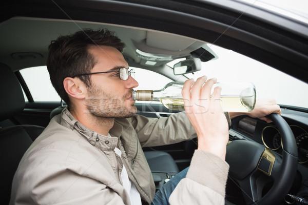 Férfi iszik sör vezetés autó üveg Stock fotó © wavebreak_media