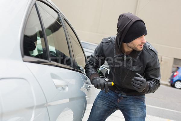 Thief breaking into car with screwdriver Stock photo © wavebreak_media