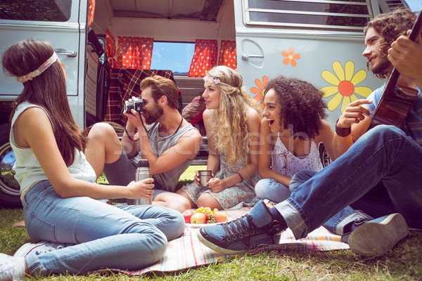 Hipster friends by camper van at festival Stock photo © wavebreak_media