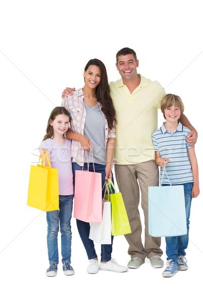 Boldog család hordoz bevásárlótáskák portré fehér nő Stock fotó © wavebreak_media