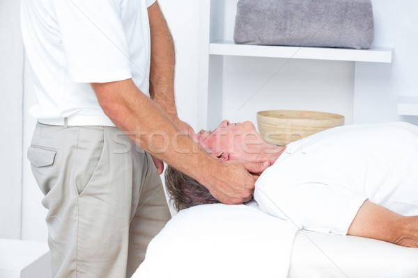Adam boyun masaj tıbbi ofis kafa Stok fotoğraf © wavebreak_media