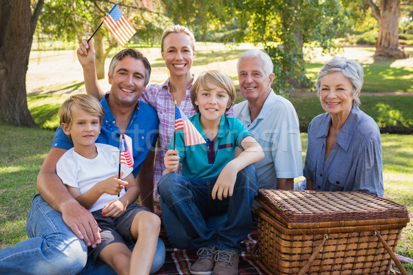 счастливая семья парка американский флаг дерево Сток-фото © wavebreak_media