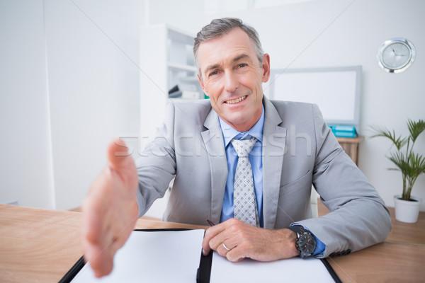 бизнесмен предлагающий руками служба человека счастливым Сток-фото © wavebreak_media