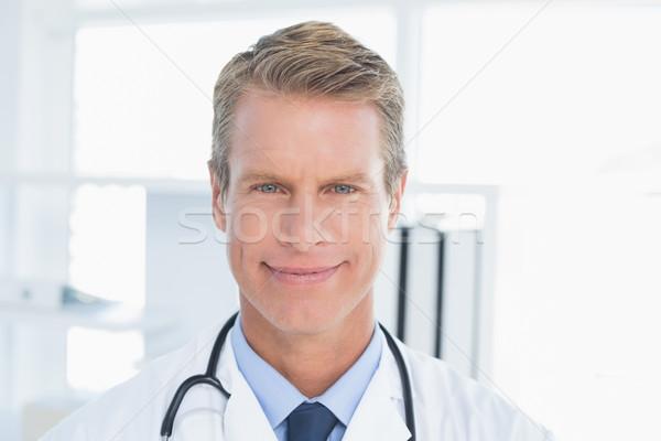 улыбаясь врач глядя камеры медицинской служба Сток-фото © wavebreak_media