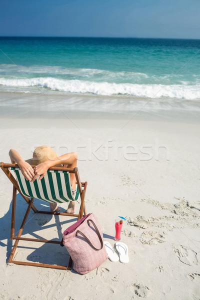 Güzel esmer rahatlatıcı güverte sandalye Stok fotoğraf © wavebreak_media