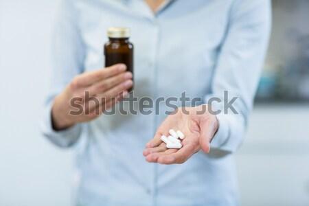 Businessman holding electronic cigarette and cigarettes Stock photo © wavebreak_media