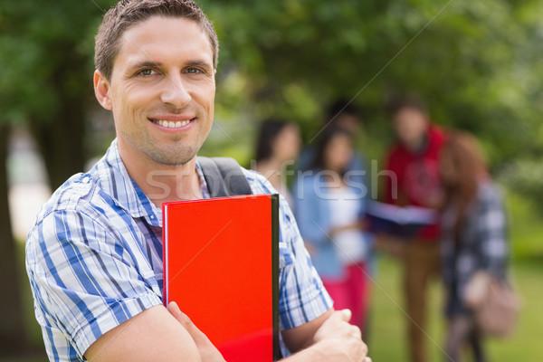 Boldog diák mosolyog kamera kívül kampusz Stock fotó © wavebreak_media