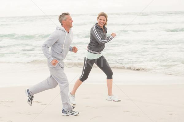 Geschikt paar jogging samen strand gelukkig Stockfoto © wavebreak_media