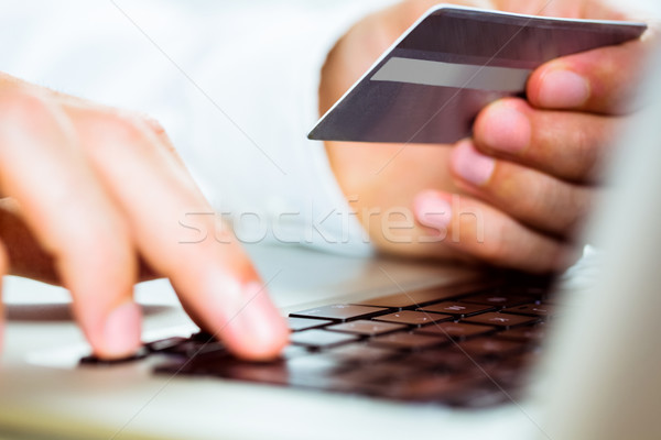 Man using laptop for online shopping Stock photo © wavebreak_media