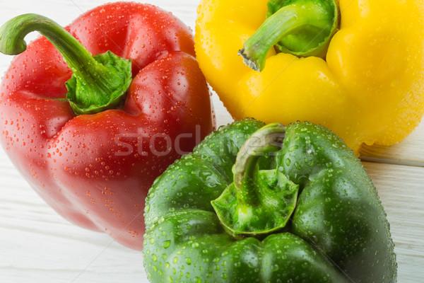 Tre peperoni tagliere copia spazio cucina verde Foto d'archivio © wavebreak_media