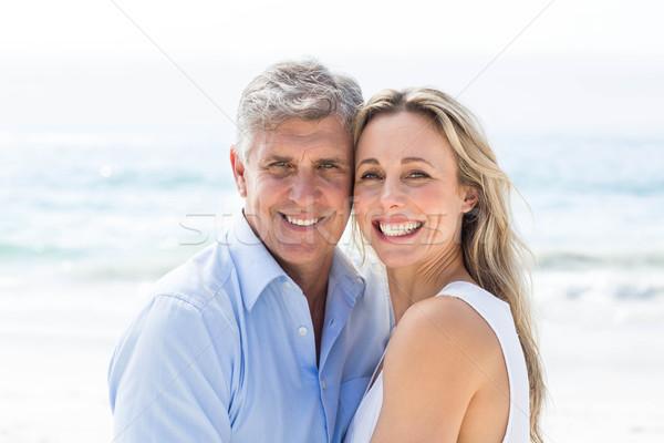 Boldog pár áll tenger mosolyog kamera Stock fotó © wavebreak_media