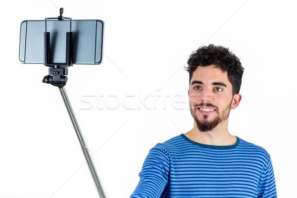 Stockfoto: Toevallig · man · stick · shot · studio · glimlachend