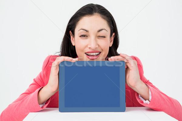 Elegáns barna hajú mutat tabletta kacsintás fehér Stock fotó © wavebreak_media