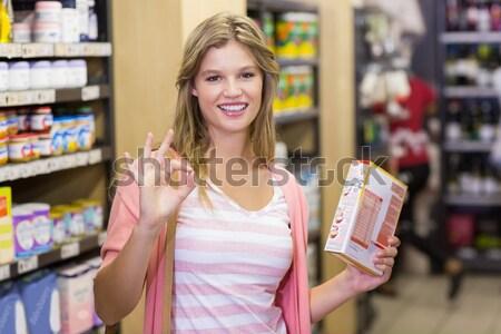 Sorrindo caixa registradora cartão de crédito supermercado negócio Foto stock © wavebreak_media