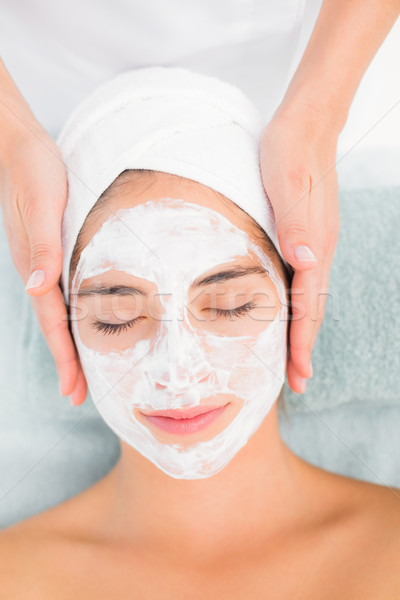 Attractive woman receiving treatment at spa center Stock photo © wavebreak_media