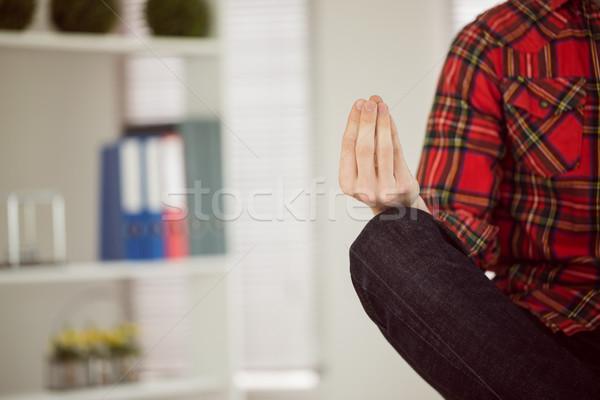 Hipster businessman meditating at his desk Stock photo © wavebreak_media