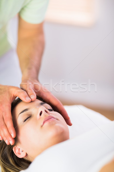 Relaxed pregnant woman getting reiki treatment Stock photo © wavebreak_media