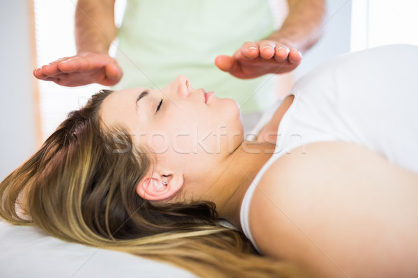 Close up view of relaxed pregnant woman getting reiki treatment Stock photo © wavebreak_media
